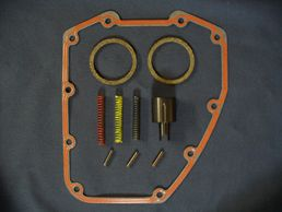 Harley Twin Cam oil pressure relief valve spring kit with cam cover and exhaust gaskets.