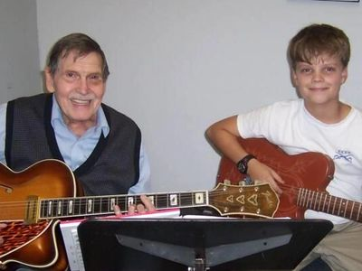 Charlie Wood, with a young student