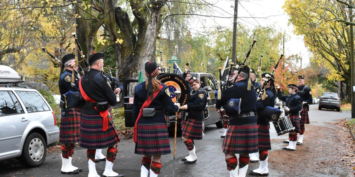 Bagpipe band prepares for parade