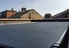 EPDM roof renewal with new red clay ridges