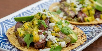 Grilled Marinated Skirt Steak Tacos with Pineapple Salsa and Tomatillo Sauce