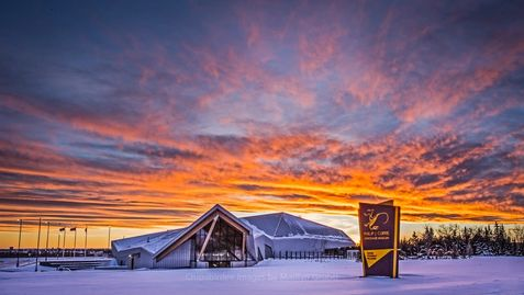 Peace Country's winter sunset over the Philip J Currie Dinosaur Museum