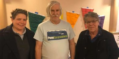 This is a photo of Nancy Guenst with climate activist John Coffey and campaign manager Andrea Myers.
