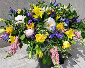 Casket spray with lily, irises and peonies