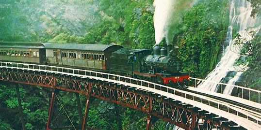 "North Queensland,  Ellis rides the cow-catcher on the Kuranda steam train ""for a better view"""