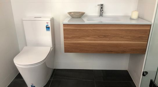 Back to wall toilet suite and wall hung vanity unit installed by Bridgewater Plumbing.