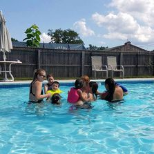 Children in pool at the Speech Language Pathology in Motion CAMP program