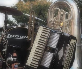 The Foothills Oompah Band instruments on stage at an Oktoberfest.  Photo by Shannon Stone.