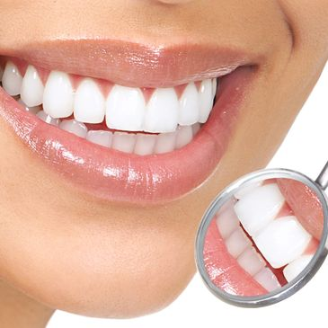 Beautiful, white teeth and a healthy smile after teeth whitening at Jonathan Loughlin Dental.