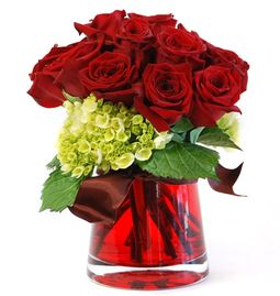 Arrangement of red roses in a red glass vase.
