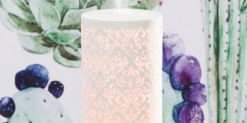 essential damask white ceramic oil diffuser with mist and purple blue and green floral background