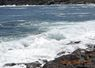Waves cresting the shores along the main road in Pouch Cove