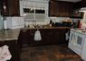 Kitchen has all the usual amenities, including full size F/S, counter microwave and dishwasher, toaster, coffee makers, dishes, mugs, glasses, cutlery