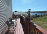 Side patio has a nice ovean view and is a great place to catch some evening rays. Overlooks a very private side yard