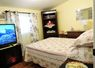 Second bedroom has firm double bed, 48 in TV on fireplace stand, dresser, corner unit, night table, extra linen