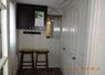 Front porch. Bifold doors conceal closet, recycling arean, and stackable full sized washer and dryer