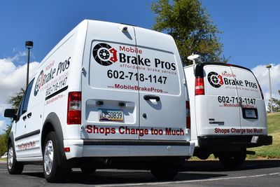 two mobile brake pros service vans in a park