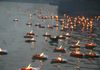 at the end of the cermony, floating butter lamps in River Ganges in Haridwar city -India.