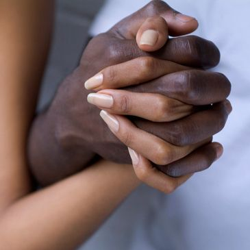 African American male and female holding hands.