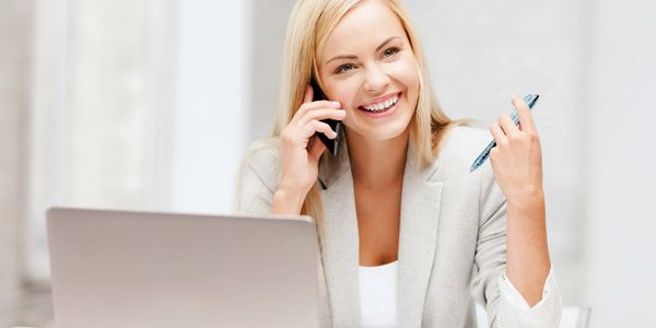 woman smiling and working
