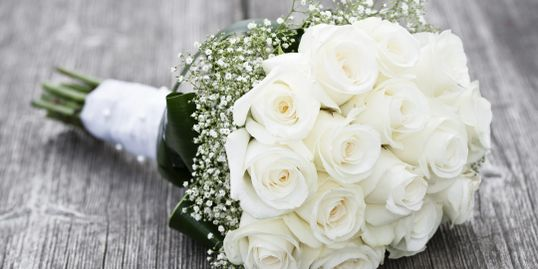 White rose bridal bouquetwith gypsillium border