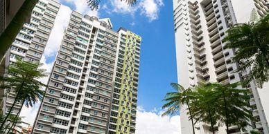 Residential building, condo, condominium with palms in south florida