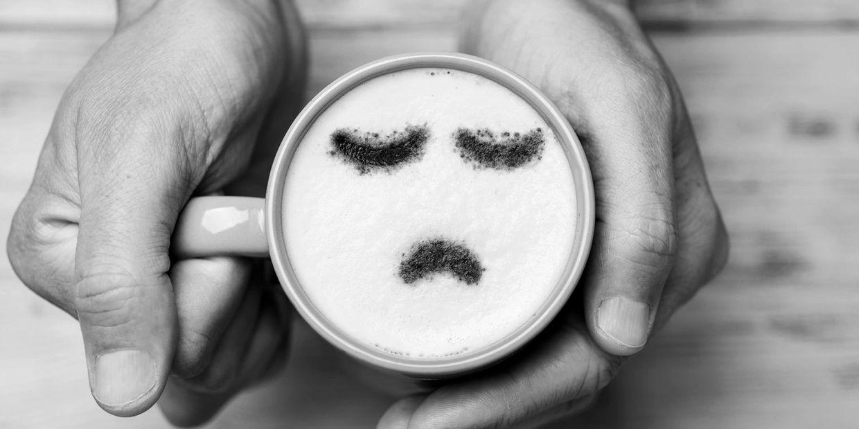 Latte with a sad face foam.