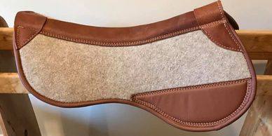 Wool felt half pads designed to meet all your and your horses requirements
