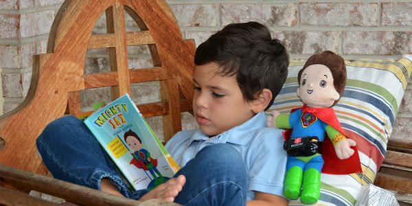 Mighty Jax is having his favorite book, Mighty Jax and the Cookie Surprise read to him!