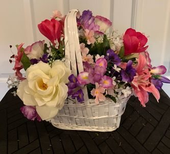 All around arrangement in white  basket  soft spring silk flowers