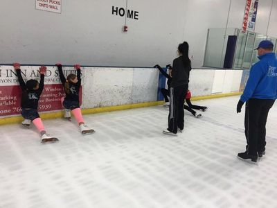 Club members enjoy a group lesson during a skating social.