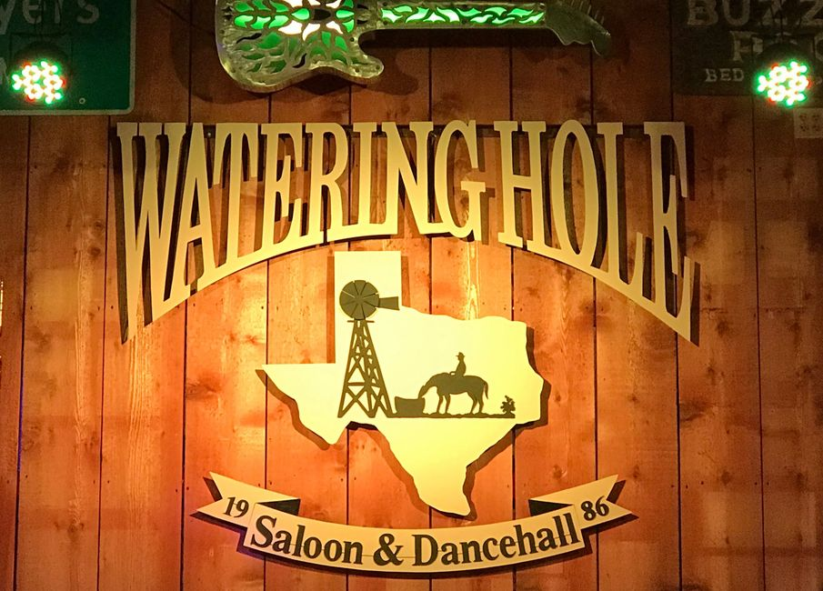 Watering Hole Saloon & Dance Hall Logo drink specials, live music, great bands, dancing