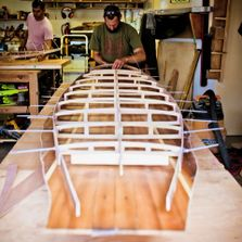 wooden surfboard workshop frame