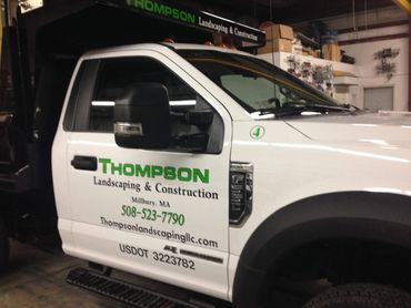Truck lettering with vinyl graphics. Thompson Landscaping, Millbury, MA