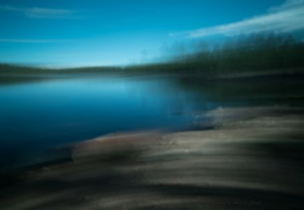 Slow pan of Willow Lake, Mogollon Rim, Arizona gives impressionist or abstract feeling to the photo