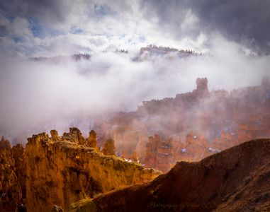 Photo of Bryce Canyon Sunset Point with fog delineating the rows of rock formations