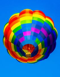 Multi colored hot air balloon with flame at Lake Havasu Balloon Festival.
