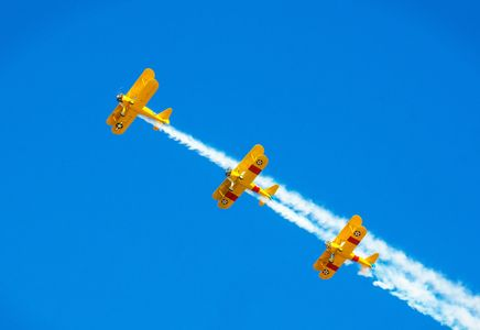 The yellow biplanes against the blue sky allow for great contrast.  Photo taken at Lake Havasu