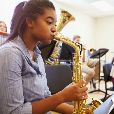Saxophone student in high school band class.