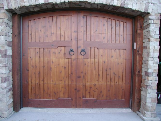 Custom wood carriage house style garage door made by Radio Controlled Garage Door and Gate