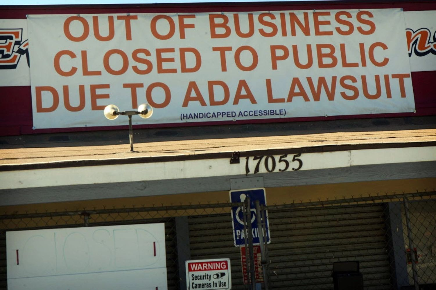 Picture of business in Riverside California, announcing that it had closed due to ADA lawsuit