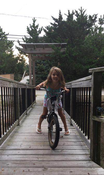 Paige loved riding her bike & going on adventures with Maeve & Ronan in Kismet Fire Island.