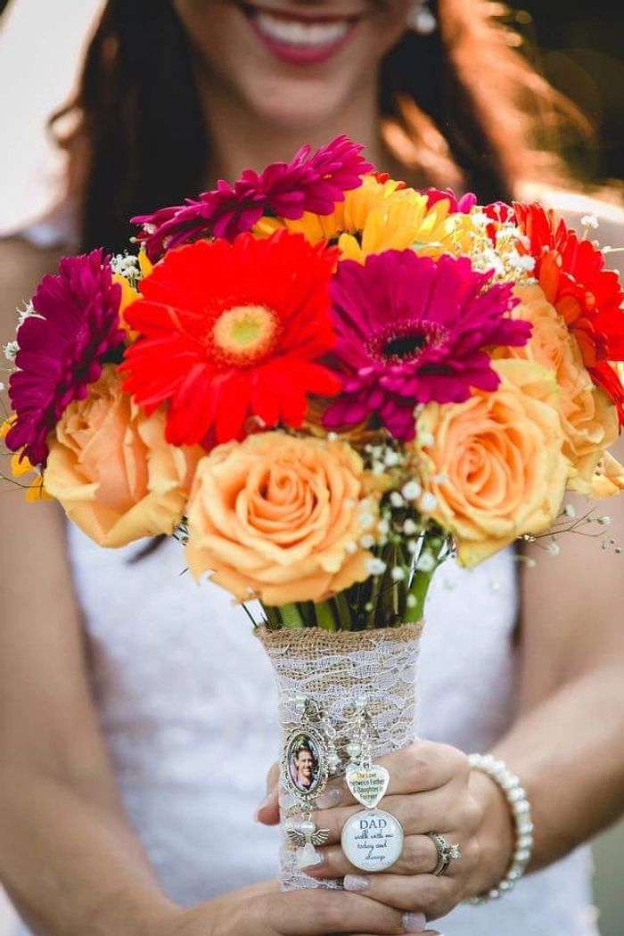 Summer wedding flower bouquet of Gerbera Daisies, Roses and Sunflowers