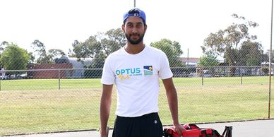 Tennis coach KAMAL GURAYA from DHA Tennis Academy in St Albans standing on tennis court