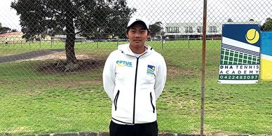 Tennis coach Darren Ha from DHA Tennis Academy in St Albans standing in front of fence