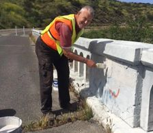 Joe Beyer, a very hard-working FBA volunteer, is shown here painting over graffiti on the Old Bonsal