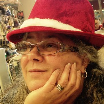 Judi Robertson - Store manager, wire wrap teacher, lapidary expert, and jewelry maker
