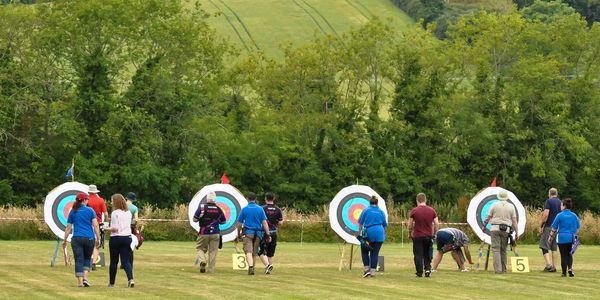 Archers retrieving arrows from targets