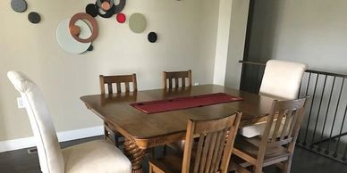 Reupholstered chairs, refinished dining table and chairs.