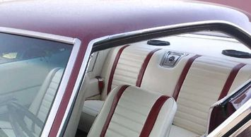 Custom interior: seats, seat belts, headliner, visors, carpet, package tray, door panels. '69 Impala